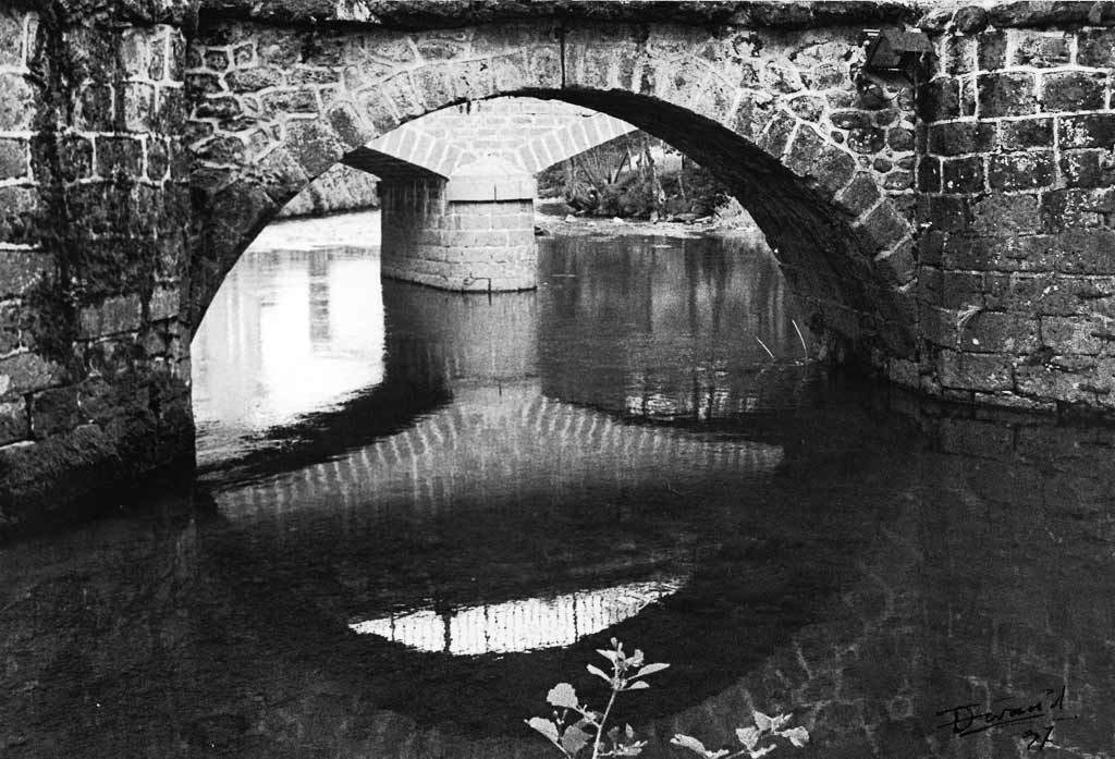 Perspective arche du vieux pont et du Pont Neuf Saint Simon Cantal